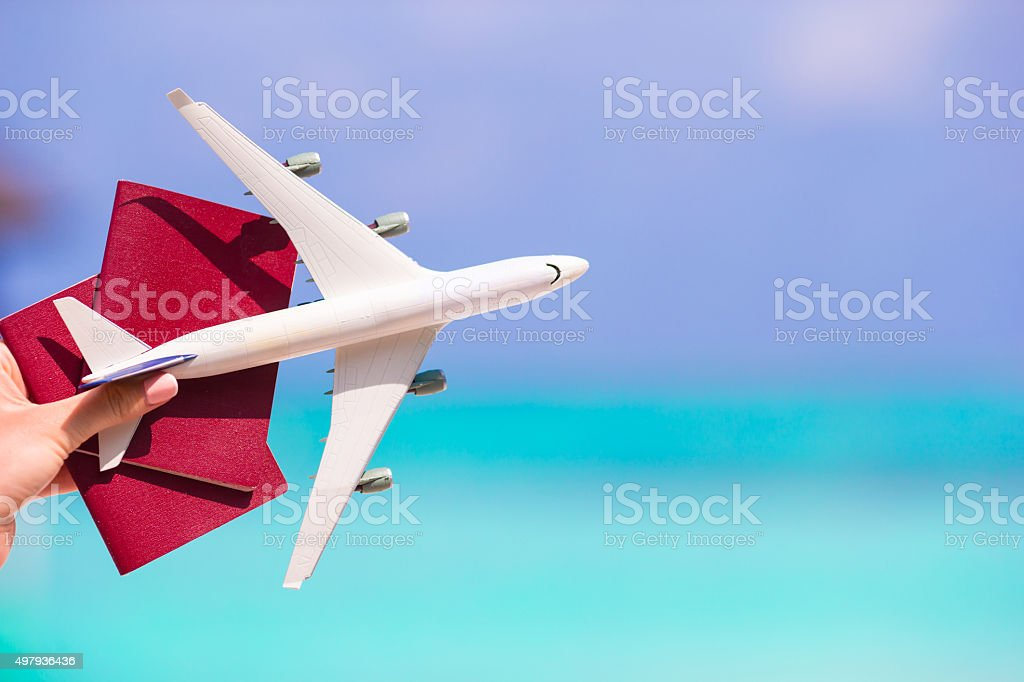Closeup of passports and white airplane background the sea stock photo