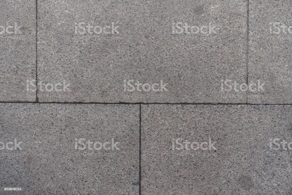 Closeup of pavement made of grey granite blocks stock photo