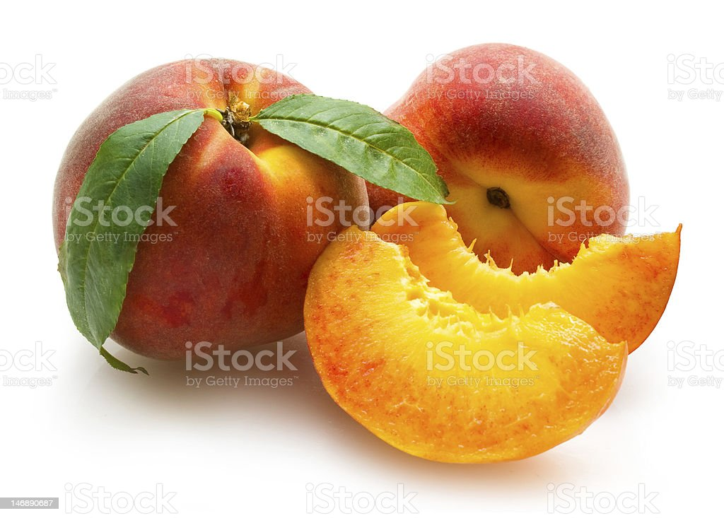Close-up of peaches and a few cut pieces royalty-free stock photo