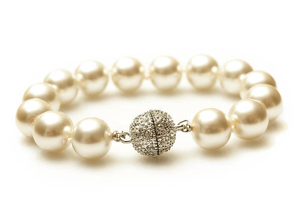 Close-up of pearl and diamond bracelet stock photo