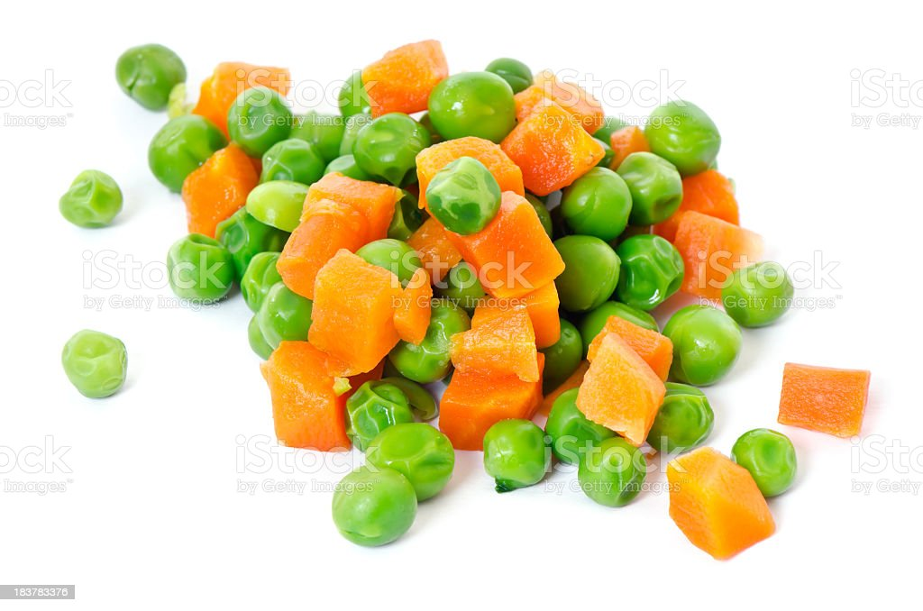 A close-up of peas and carrots royalty-free stock photo