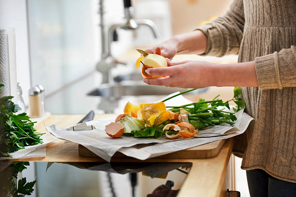 close-up of peeling apple. - food waste bildbanksfoton och bilder