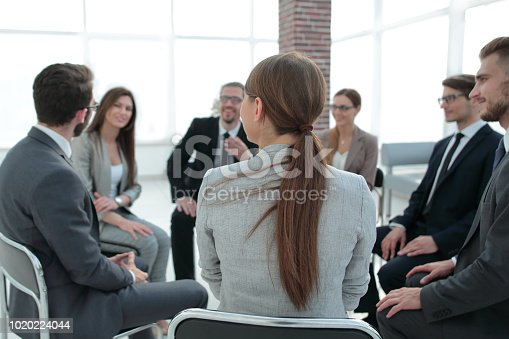 541975802 istock photo Close-up of people chatting, sitting in a circle and gesturing 1020224044