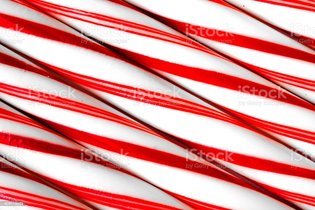 Closeup of peppermint candy canes side by side. stock photo