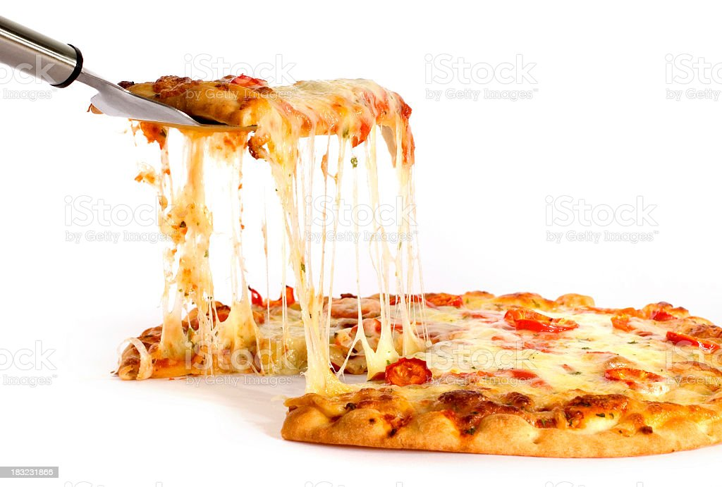 A closeup of pepperoni pizza with a slice getting taken out stock photo