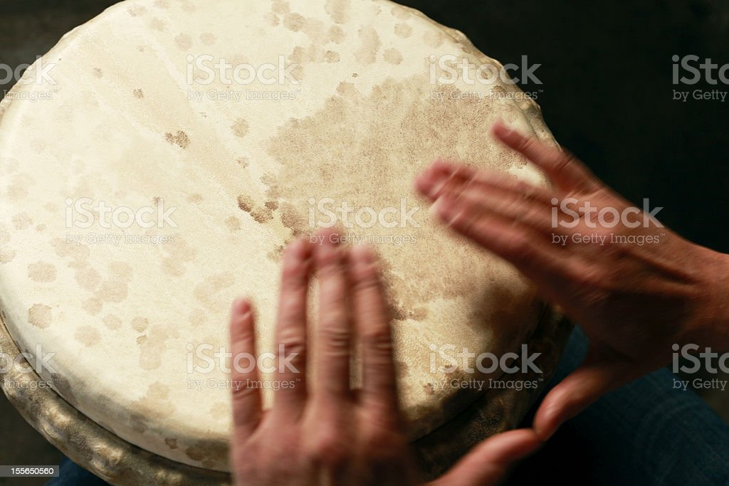 Close-up of Percussionist playing African djembe drum royalty-free stock photo