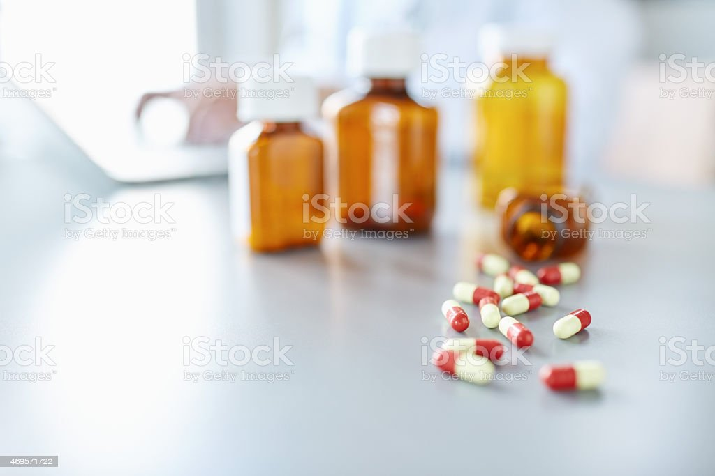 Close-up of perscription pills fallen from perscription bottle o stock photo