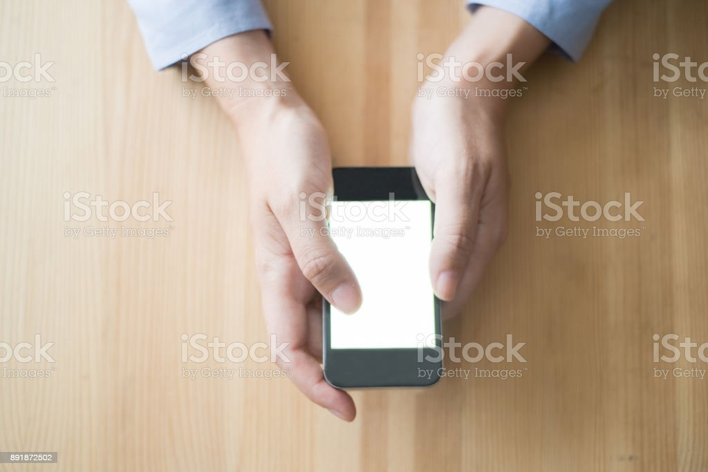 Closeup of Person Browsing on Smartphone stock photo
