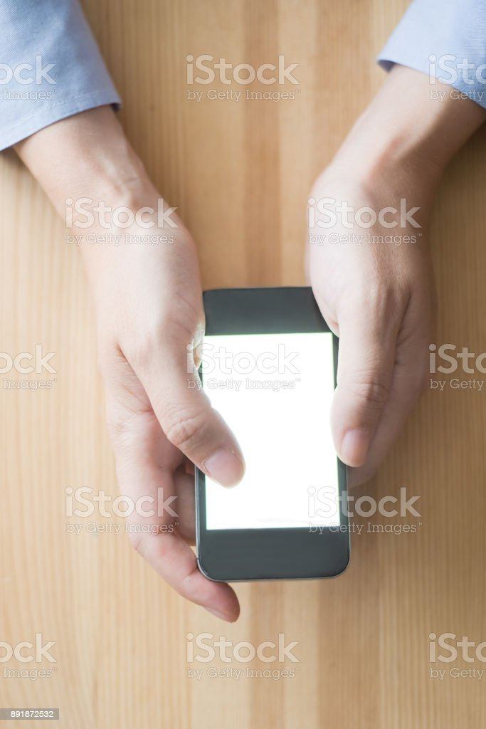 Closeup of Person Networking on Smartphone stock photo