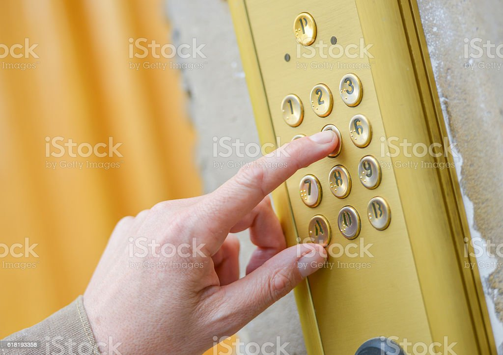 Close-up of person using building intercom stock photo