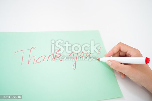 1094837778 istock photo Closeup of person writing thank you note with red marker 1024127016