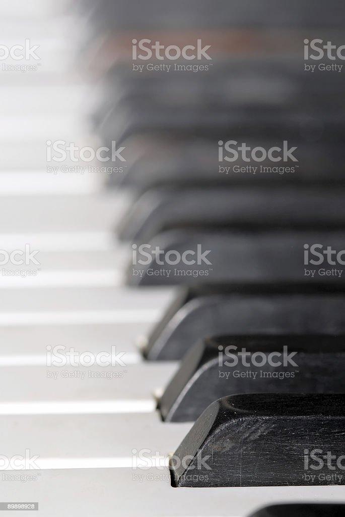 Close-up of piano keyboards royalty-free stock photo