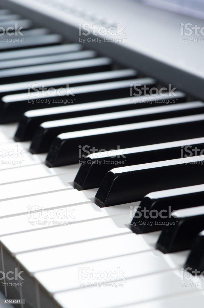 close-up of piano keys. close frontal view stock photo