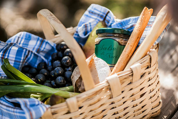 Close-up of picnic basket stocked with gourmet goodies stock photo