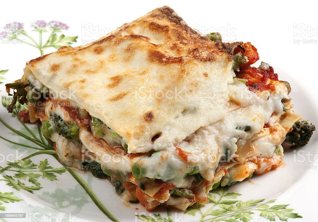 Closeup of piece of lasagna served on a white plate royalty-free stock photo