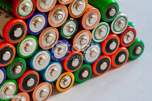 istock Closeup of pile of used alkaline batteries. Several  in rows. 1135382240