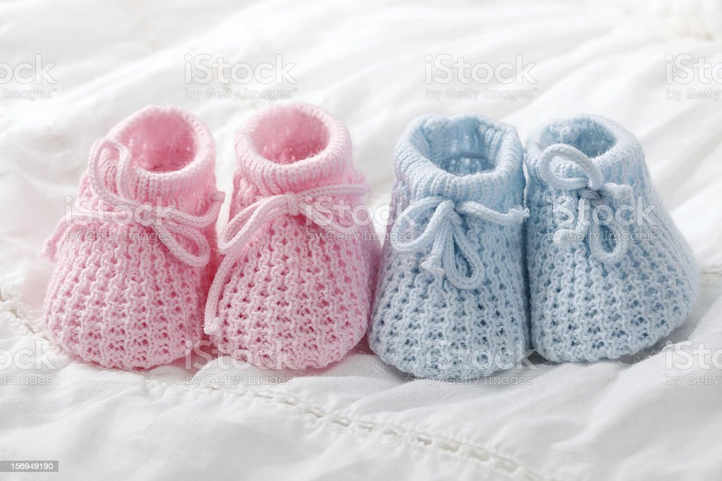 Close-up of pink and blue crocheted baby shoes stock photo