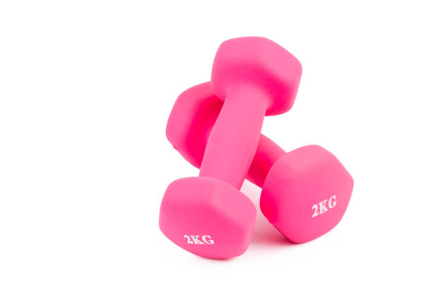 Close-Up Of Pink Dumbbells stock photo