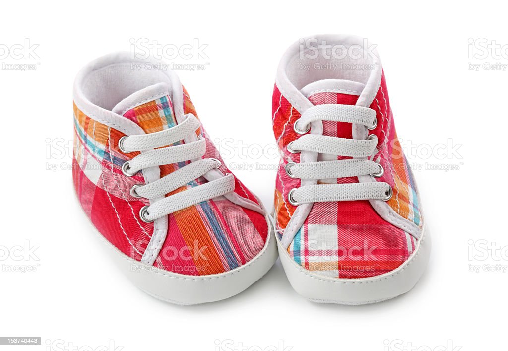 Close-up of pink plaid infant shoes royalty-free stock photo