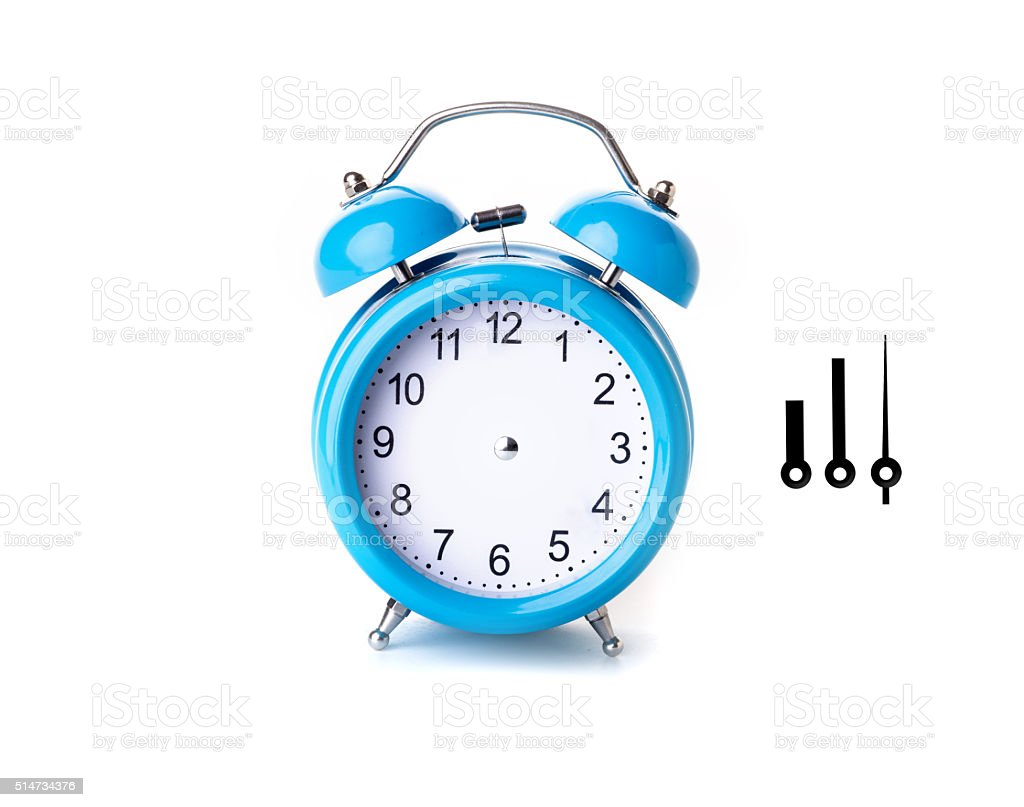 Close-up of Pink Table Alarm Clock on White Background stock photo