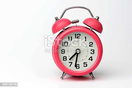 istock Close-up of Pink Table Alarm Clock on White Background 539138759