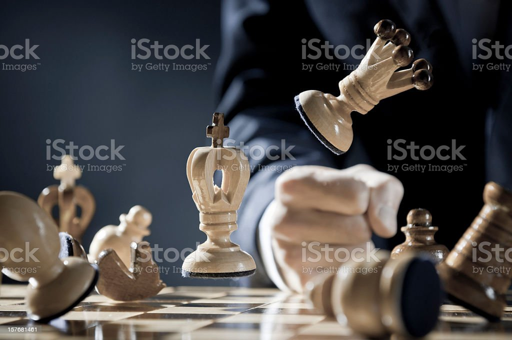 Close-up of pissed off chess player punches in the chessboard royalty-free stock photo