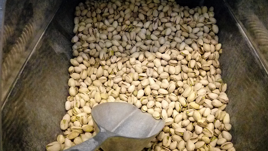 Close-up of pistachios at a market counter