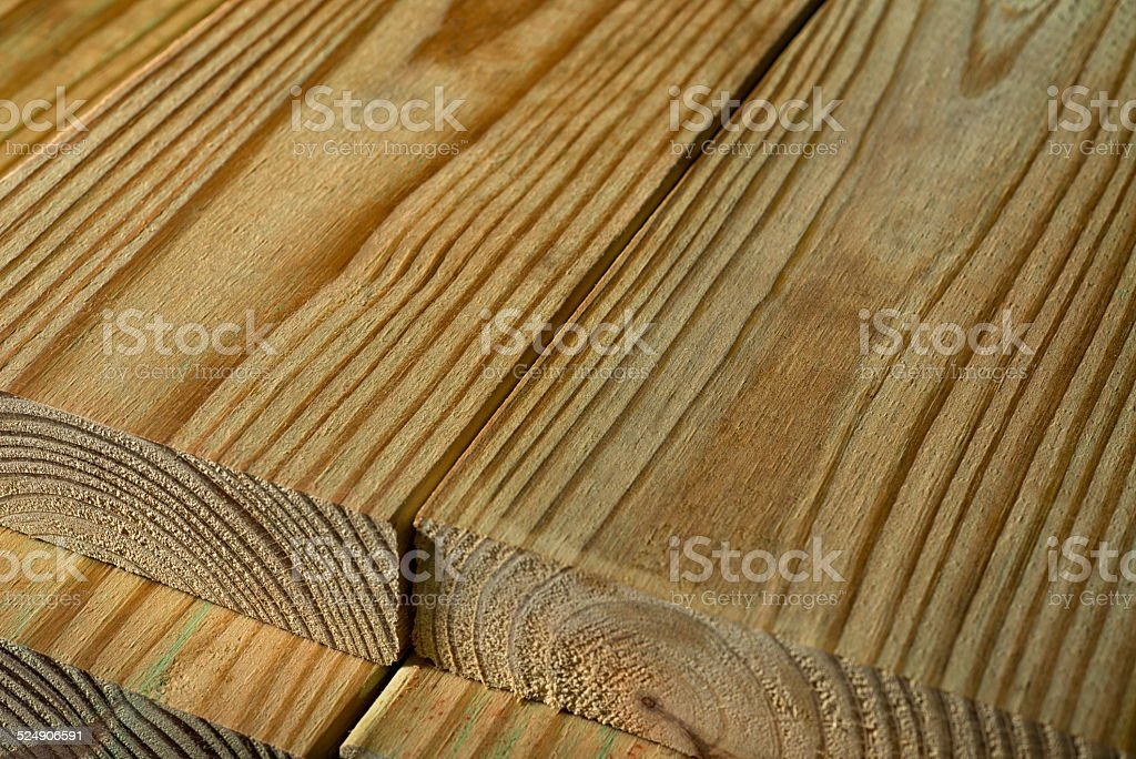Closeup of planks of pressure treated wood side by side. stock photo