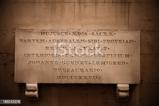 Detail of engraved stone plaque on the side of Temple Church, in the City of London, England, United Kingdom.  Text in Latin reads: Hujusce Aedis Sacrae Partem Australem Sibi Propriam Restitui Curavit Interioris Templi Hospitium Johanne Gurney Armigero Thesaurario MDCCCXXVII