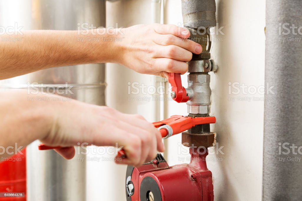 closeup of plumber hands working with pipeline connections royalty-free stock photo