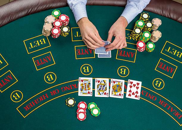 closeup of poker player with playing cards and chips - black jack bildbanksfoton och bilder