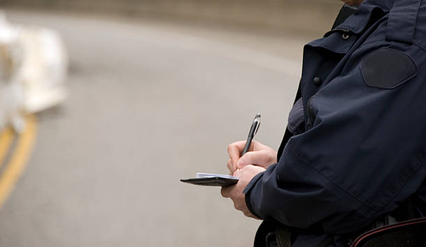 Close-up of police issuing a fine ticket stock photo