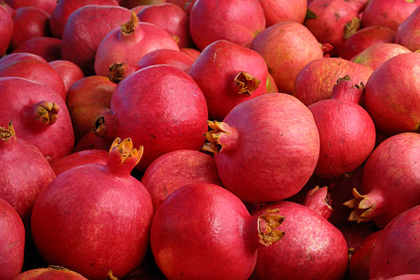 Close-up of Pomegranates Packed in Shipping Crate stock photo