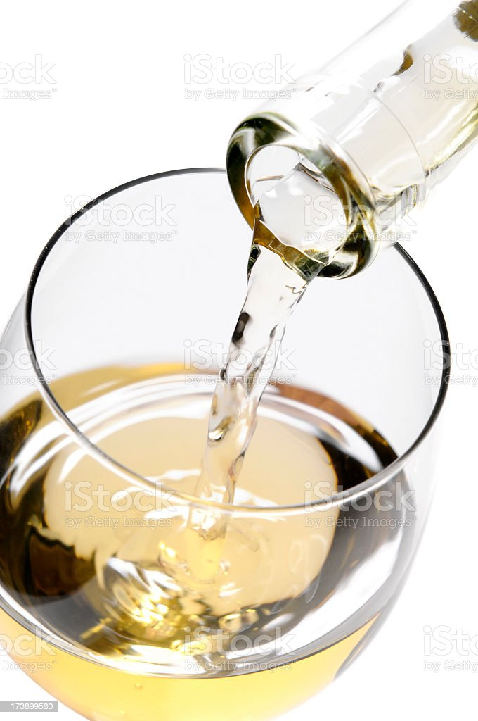 Close-up of pouring white wine into the glass, directly above royalty-free stock photo