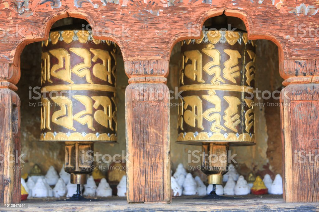 Closeup Of Prayer Wheels With Tsatsa Offerings In A Buddhist Temple In Paro  Bhutan Stock Photo - Download Image Now