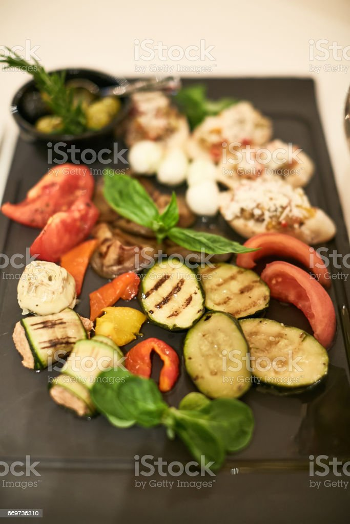 closeup of prepared garlic and vegetables stock photo