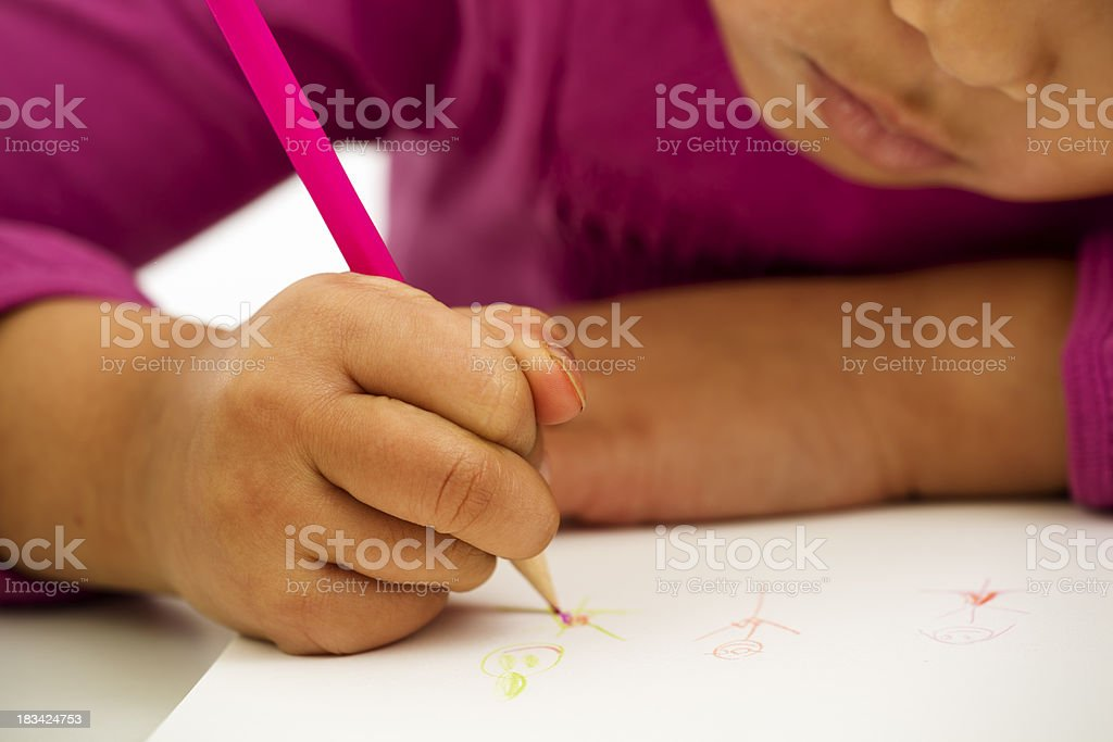 Close-Up of Preschooler Writing in Notebook royalty-free stock photo