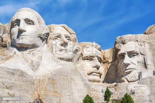 Closeup of presidential sculpture at Mount Rushmore national memorial, USA. Blue sky background