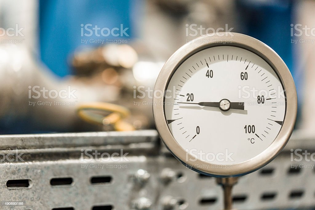 Close-up of pressure gauge at factory stock photo
