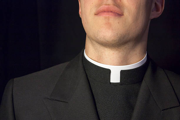 Close-up of Priest collar Close-up of Priest collar with black background. clergy stock pictures, royalty-free photos & images
