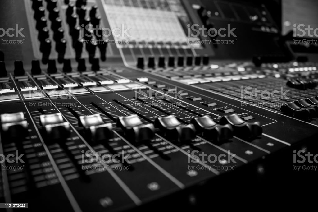 Close-up of Professional Digital Audio Sound Mixing Console. White...