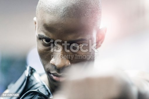 1069872470istockphoto Close-up of proud boxer in gym 541580968