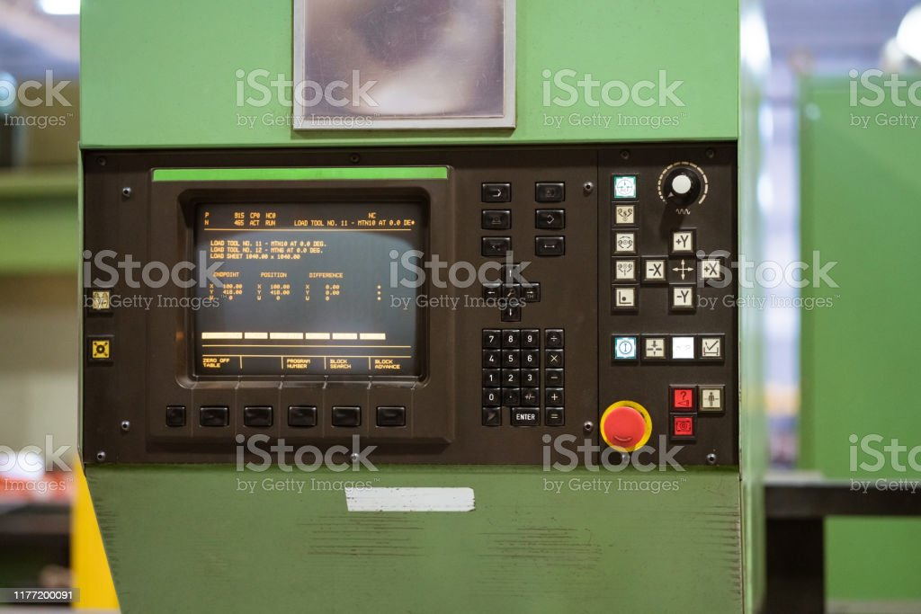 Close-up of puller machine in factory Close-up of push buttons and screen on puller machine. Manufacturing machinery in factory. Absence Stock Photo