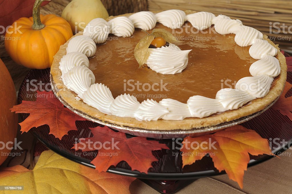 Close-up of pumpkin pie on autumn decorated table royalty-free stock photo