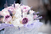Close-up of white and purple roses and lavanda in a stone vase, Slovenia, Europe. Nikon D850.