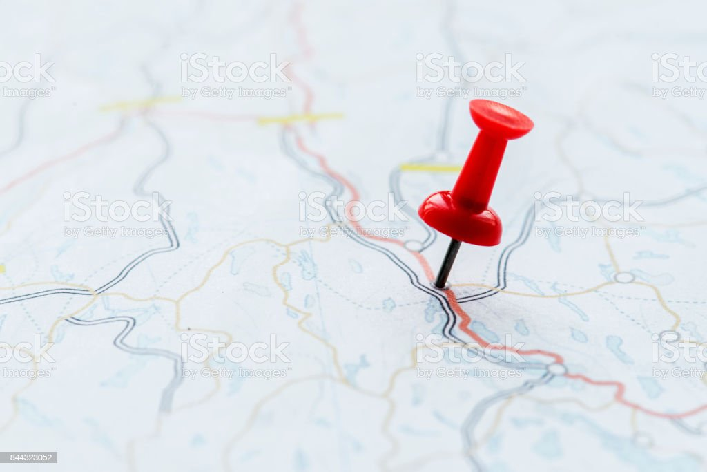 Closeup of pushpin showing the location on the map stock photo
