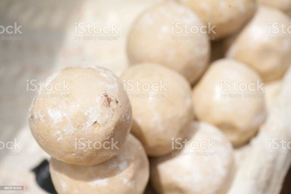 Closeup of raw cereal balls used for making bread in a dirty str stock photo