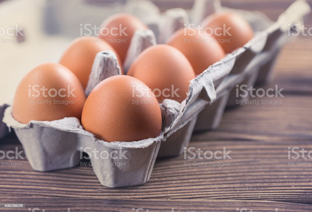 Closeup Of Raw Chicken Eggs In A Box Eggs On An Old Wooden Table