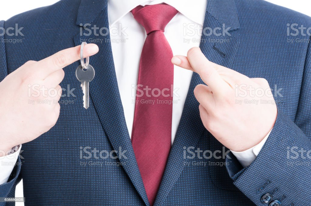 Close-up of real estate agent showing keying and fingers crossed stock photo