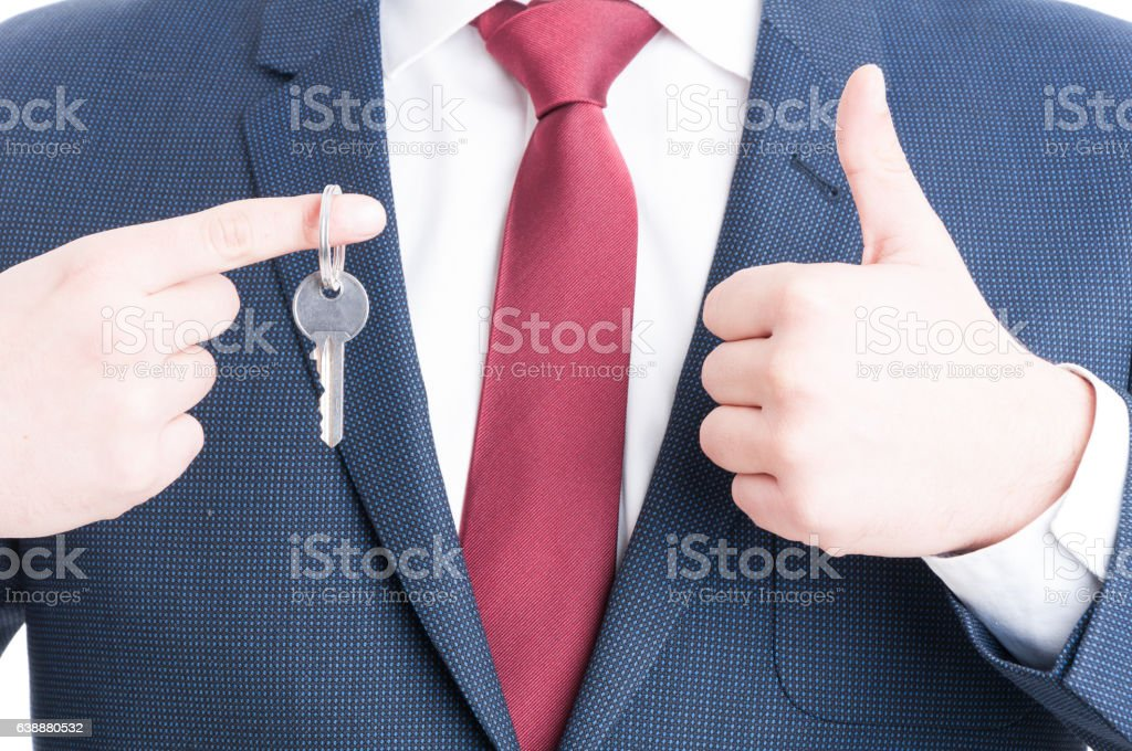 Close-up of real estate agent showing keying and like stock photo